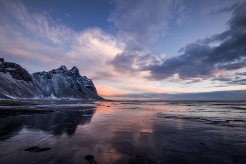 Sky Nature Water Sun Ocean Landscape Clouds Calm Winter Beach Mountain Environment Emotions Coast Snow Moody