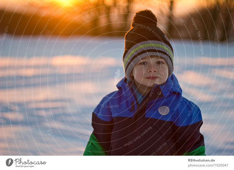 winter sun Human being Masculine Child Toddler Boy (child) Face 1 1 - 3 years 3 - 8 years Infancy Environment Nature Winter Snow Jacket Cap Smiling Cold Small