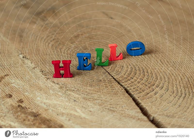 word hello from small wooden letters on a stump Blue Green Red To talk Wood Small School Brown Orange Communicate Idea Toys Text Date Hello Salute