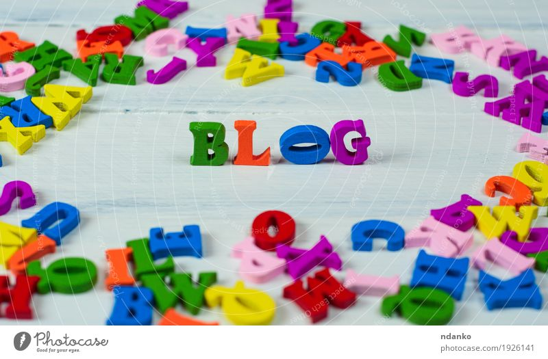 wooden colorful letters of the english alphabet blue green white red yellow to talk small school