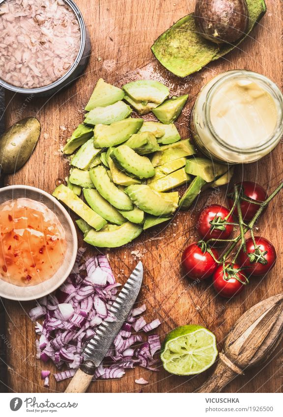 Sliced avocado with knife and cooking ingredients Food Vegetable Lettuce Salad Herbs and spices Cooking oil Nutrition Lunch Buffet Brunch Organic produce