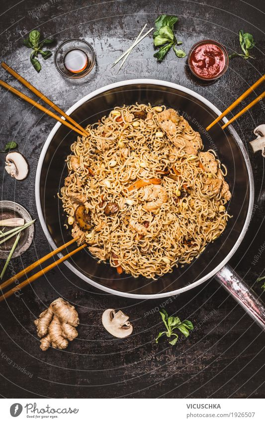 Asian fried noodles in wok pan with chopsticks Food Nutrition Lunch Banquet Asian Food Crockery Pan Style Design Healthy Eating Restaurant Chopstick Wok Noodles