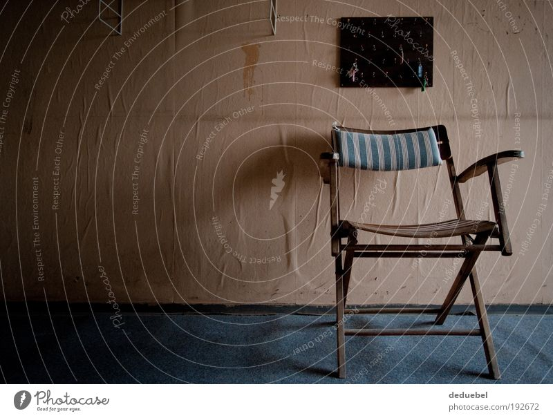 "Folding chair with wallpaper and key board Chair Old ""Carpet Blue Wooden chair Leave Colour photo Interior shot Copy Space left Morning Central perspective Day"