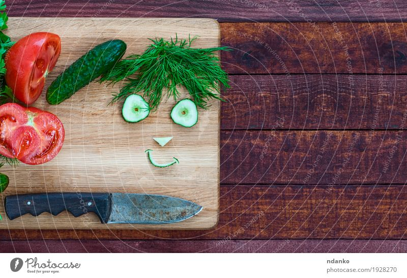smiley face made of pieces of fresh vegetables Vegetable Herbs and spices Vegetarian diet Knives Wood Diet Eating Fresh Delicious Funny Cute Brown Green Red