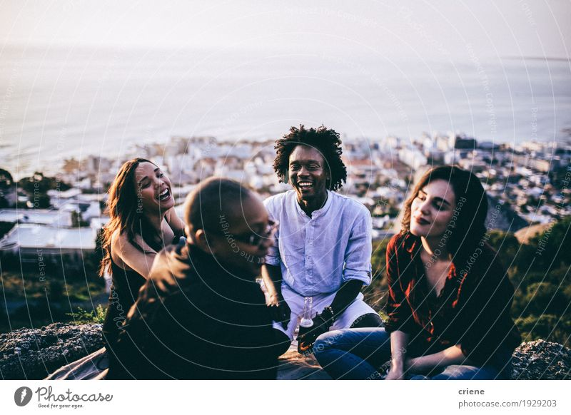 mixed race group of friends hanging out together Human being Youth (Young adults) Young woman Young man Joy To talk Emotions Lifestyle Laughter Freedom Feasts & Celebrations Group Together Friendship Sit Happiness