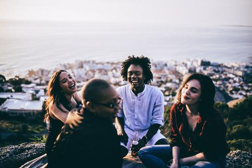 mixed race group of friends hanging out together Human being Youth (Young adults) Young woman Young man Joy To talk Emotions Lifestyle Laughter Freedom