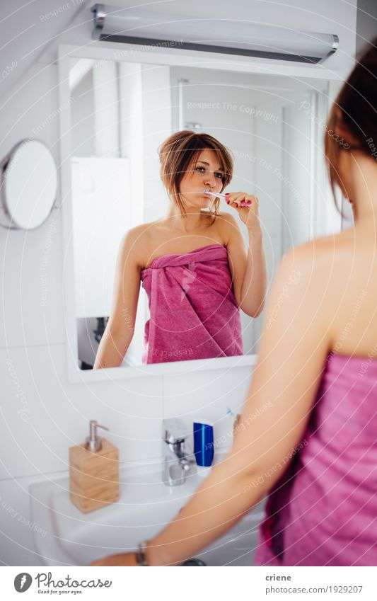 Young female adult brushing teeth in the morning Lifestyle Beautiful Personal hygiene Body Face Healthy Health care Well-being Living or residing Mirror Bathtub