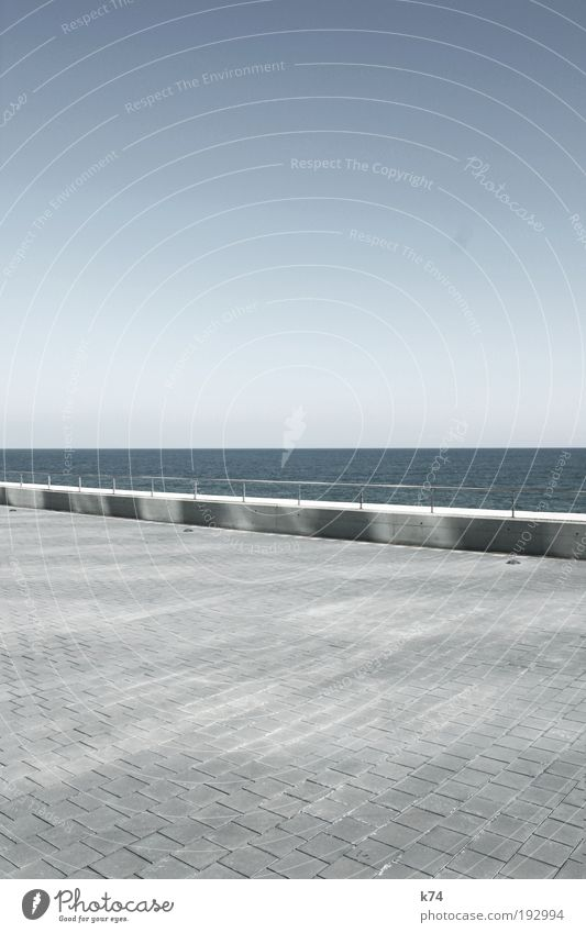 seascape with lightreflections on concrete Landscape Water Sky North Sea Baltic Sea Ocean Places Architecture Wall (barrier) Wall (building) Concrete Cold Blue