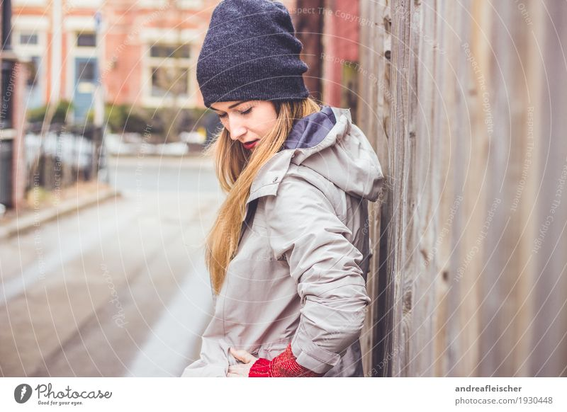 Young woman waiting for her boyfriend at the wooden fence Lifestyle Trip City trip Feminine Youth (Young adults) 1 Human being 18 - 30 years Adults Sweater