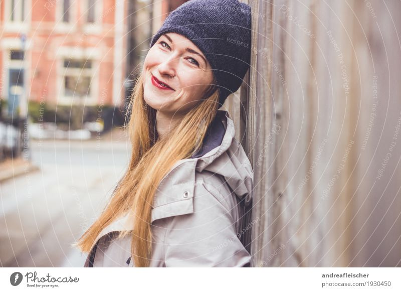 Young woman leans against wooden fence and is happy 1 Human being 18 - 30 years Youth (Young adults) Adults Small Town Outskirts Blonde Long-haired Smiling