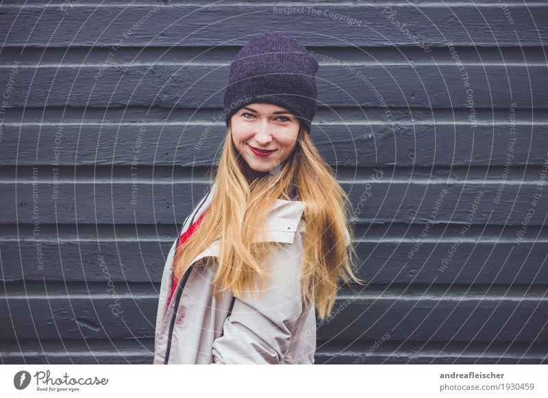 Young woman at a wooden fence Feminine Youth (Young adults) Life 1 Human being 18 - 30 years Adults Sweater Jacket Coat Cap Blonde Long-haired Movement Rotate