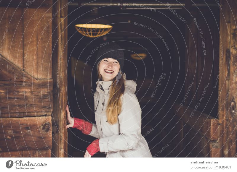 Young woman having fun on the farm Feminine Youth (Young adults) 1 Human being 18 - 30 years Adults Sweater Jacket Cap Brunette Blonde Long-haired Smiling