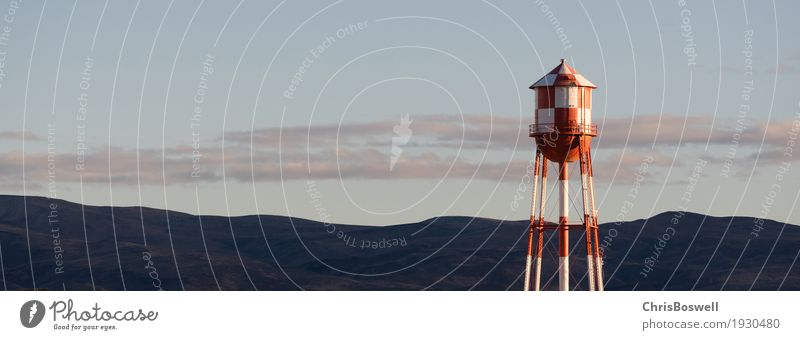 Red White Checkered Water Tower Mountain Background Industry Environment Landscape Sky Manmade structures Architecture Container Metal Steel Blue tower