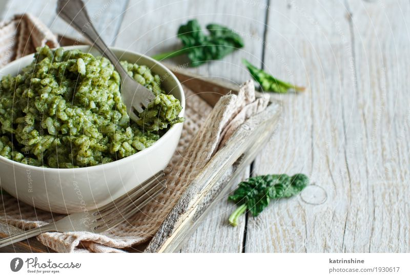 Risotto with spinach cream in a bowl Vegetable Nutrition Lunch Dinner Vegetarian diet Italian Food Bowl Fork Summer Wood Fresh Tradition colorful Dish food