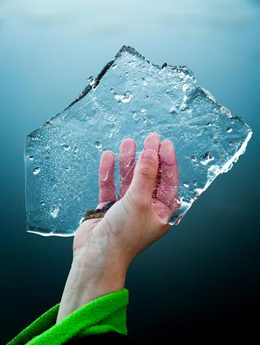 Young boy keeps in hand slice of ice floe in cold hand Playing Winter Examinations and Tests Boy (child) Infancy Hand Feet Nature Lake Drop Cool (slang) Fresh
