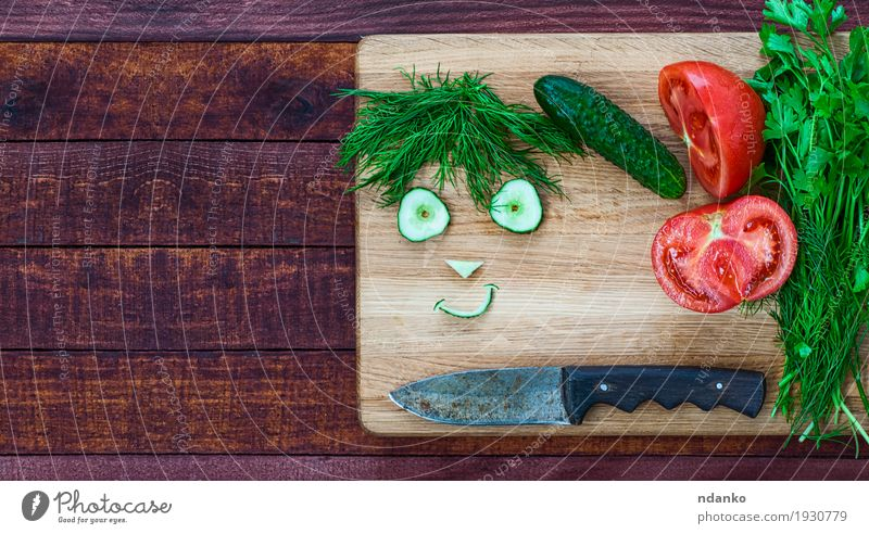 smiley face made of pieces of fresh vegetables Food Vegetable Vegetarian diet Knives Smiling Fresh Delicious Funny Cute Brown Green Red Happiness Humor Tomato