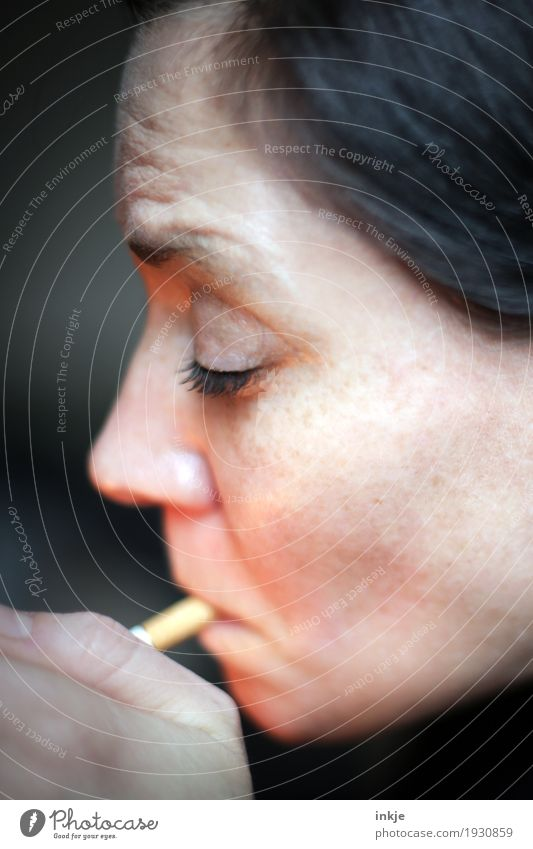 fag Lifestyle Smoking Woman Adults Face 1 Human being 30 - 45 years 45 - 60 years Cigarette Addiction Ignite Lighter Colour photo Interior shot Close-up