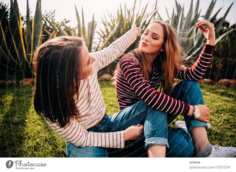 Young happy teenager friends having fun chatting to each other Human being Woman Youth (Young adults) Young woman Joy Girl 18 - 30 years Adults Lifestyle Feminine Happy Fashion Moody Together Friendship 13 - 18 years