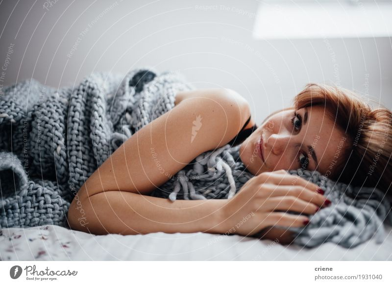 Young caucasian women laying in bed looking at camera Lifestyle Well-being Living or residing Flat (apartment) Bed Room Bedroom Human being Feminine Young woman