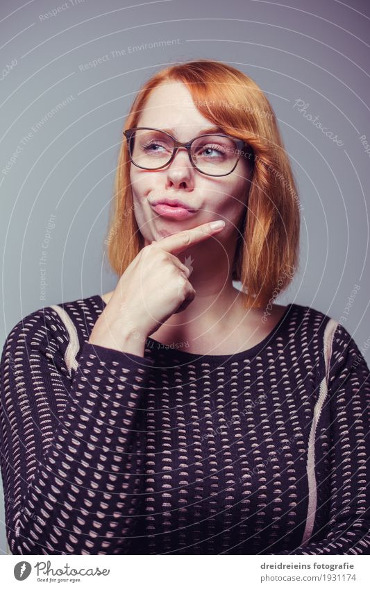 thoughtful. Lifestyle Media industry Advertising Industry Feminine Young woman Youth (Young adults) Woman Adults Eyeglasses Red-haired Think Success Brash Nerdy