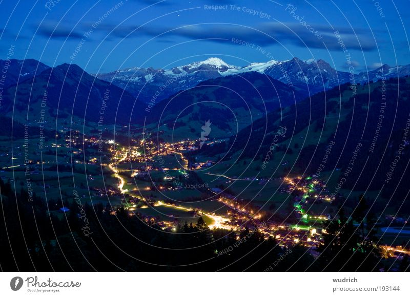 bedtime Landscape Clouds Night sky Summer Hill Alps Mountain Snowcapped peak Gstaad Switzerland Village Traffic infrastructure Motoring Street Street lighting