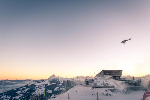 Hahnenkamm mountain station Tourism Freedom Winter Snow Winter vacation Mountain Skiing Logistics Aviation Landscape Sky Cloudless sky Horizon Sunrise Sunset