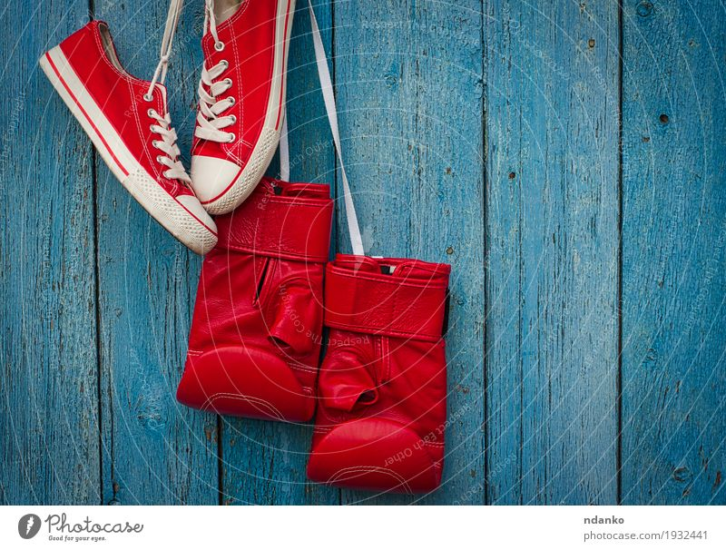 Red shoes and red boxing gloves hanging on a rope Old Blue Colour Sports Style Wood Fashion Design Dirty Success Footwear Clothing Fitness Protection Ring