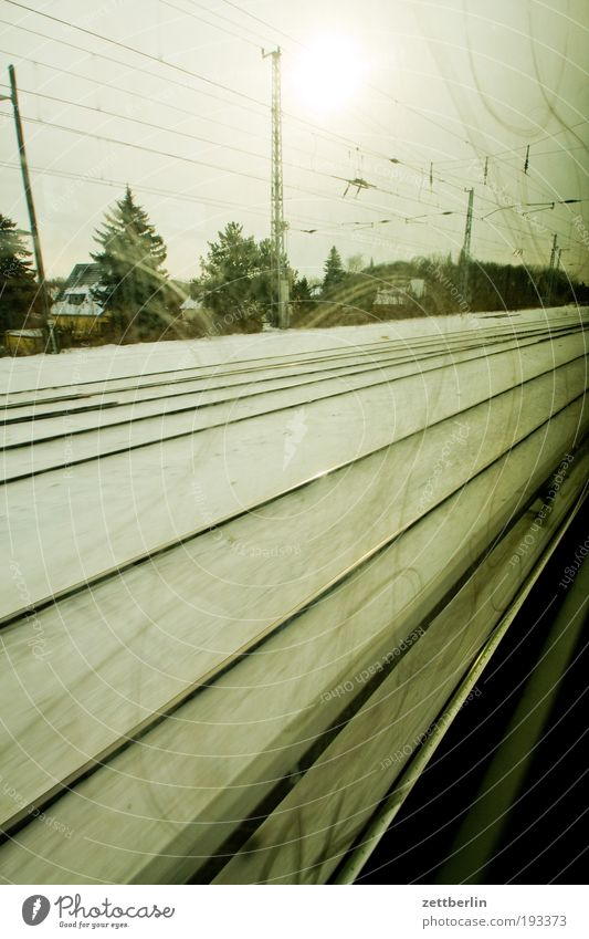 Sky Sun Winter Vacation & Travel Snow Berlin Window Sadness Railroad Speed Gloomy Travel photography Railroad tracks Track Clouds In transit