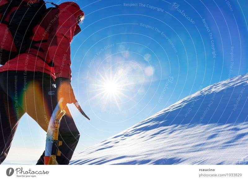 Extreme winter sports Human being Nature Vacation & Travel Man Colour Landscape Red Loneliness Winter Mountain Adults Snow Sports Copy Space Hiking Power