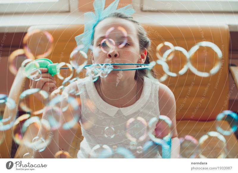 little girl and soap bubbles Leisure and hobbies Girl 8 - 13 years Child Infancy To enjoy Happy Emotions Enthusiasm Euphoria Playing Soap bubble Schoolchild