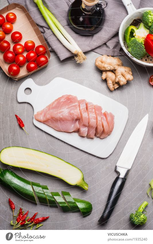 Cut raw chicken breast fillet on white chopping board Food Meat Vegetable Herbs and spices Cooking oil Nutrition Lunch Dinner Organic produce Diet Slow food