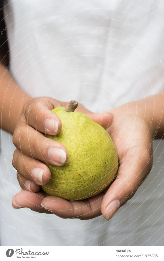 close up of hands - woman holding a yellow pear Fruit Vegetarian diet Diet Summer Garden Thanksgiving Gardening Human being Woman Adults Hand Fingers Nature