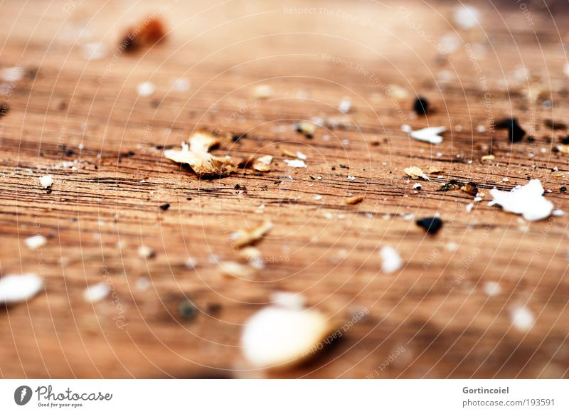 fullness Crumbs Wooden board Chopping board Breadcrumbs Dry Brown Remainder Colour photo Subdued colour Close-up Detail Macro (Extreme close-up)