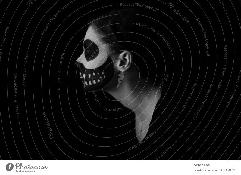 . Make-up Carnival Hallowe'en Human being Face Ear Teeth 1 Sadness Threat Dark Creepy Emotions Moody Concern Death Pain Loneliness Fear Fear of death Dangerous