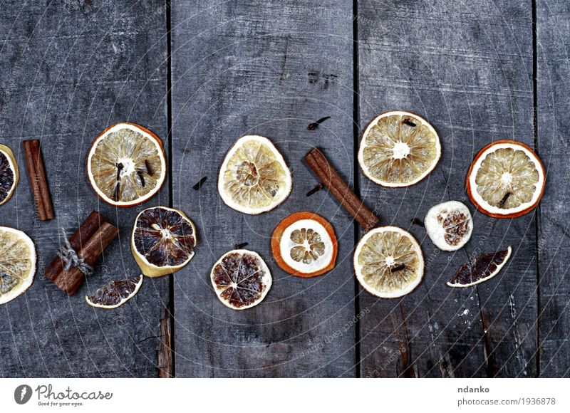 Slices of orange and lemon on a gray wooden surface Old Christmas & Advent Tree Yellow Natural Wood Above Orange Fruit Fresh Retro Vantage point Table