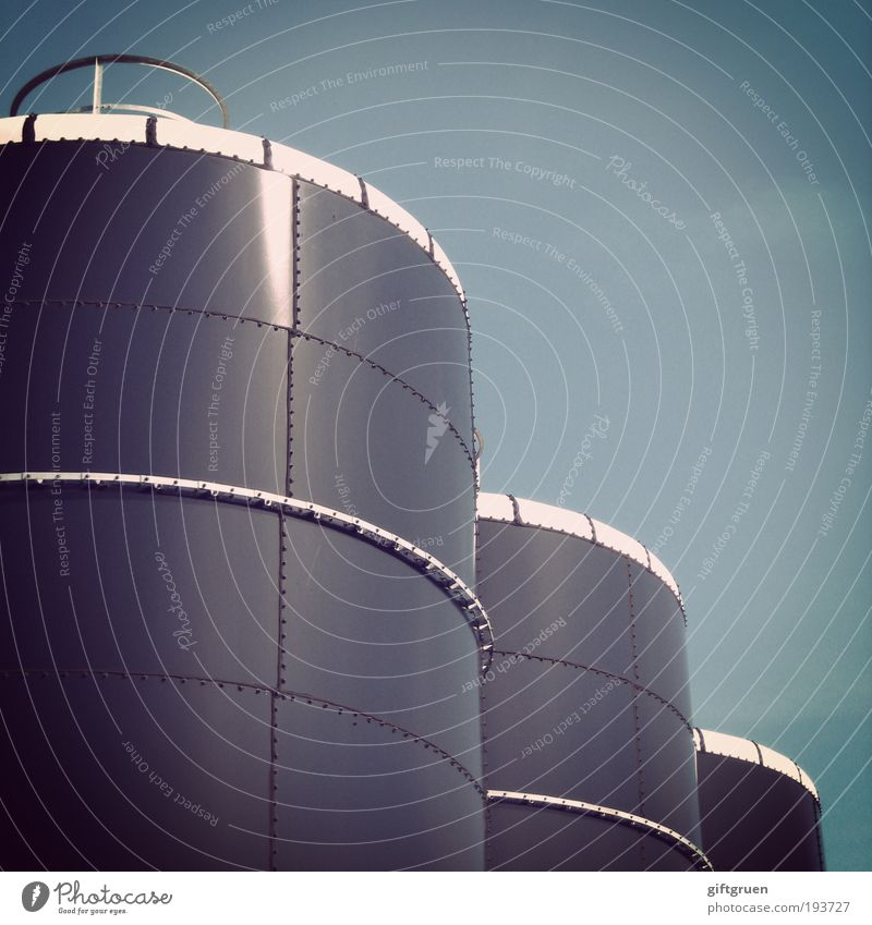 by the ton Industrial plant Factory Large Round Keg Containers and vessels Industry Tank Cylinder Geometry Sky Worm's-eye view Gas tank Energy industry Tower