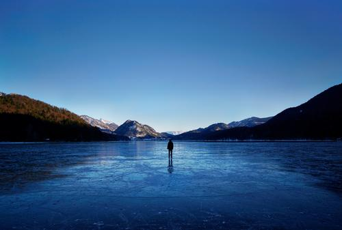 Walking on Ice Frozen surface Human being 1 Environment Nature Landscape Water Sky Horizon Winter Beautiful weather Frost Forest Hill Mountain Lake Fuschlsee