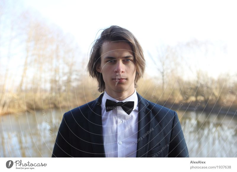 ready to go out - young man in suit with bow tie in front of a lake in autumn Style Young man Youth (Young adults) Face 18 - 30 years Adults Landscape Plant Sky