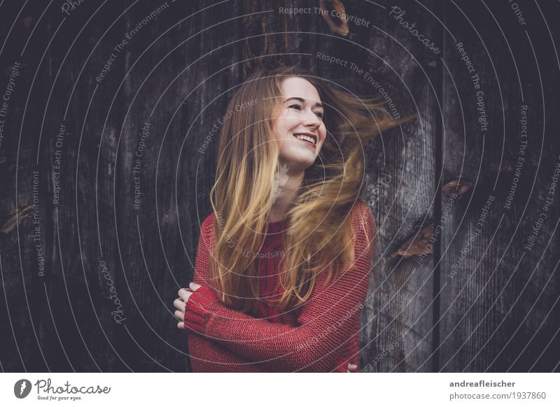 Young woman is happy Feminine Youth (Young adults) Life 1 Human being 18 - 30 years Adults Sweater Brunette Blonde Long-haired Part Observe Touch Movement