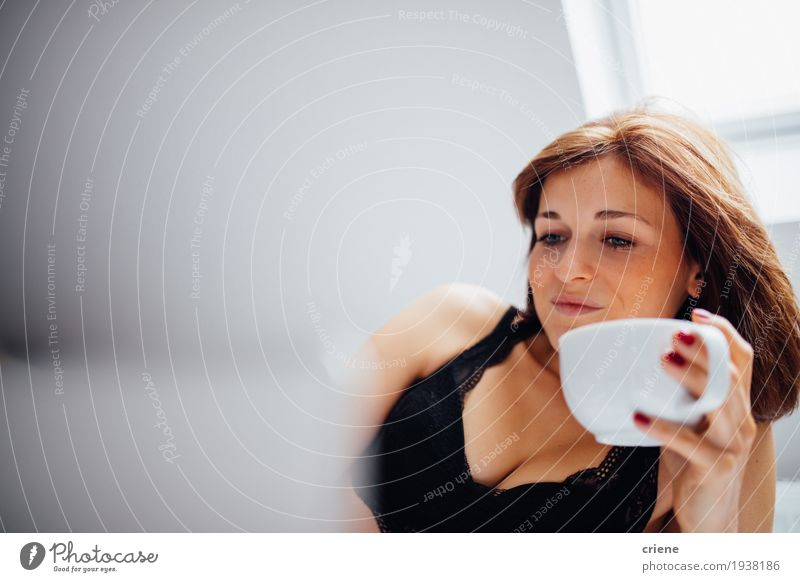 Young caucasian female laying in bed drinking cup of coffee Human being Youth (Young adults) Young woman Hand Joy Lifestyle Feminine Flat (apartment) Lie Fresh