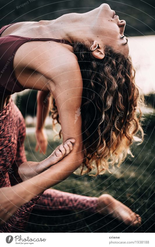 Young women doing flexible yoga exercise outside Lifestyle Beautiful Personal hygiene Body Healthy Athletic Fitness Harmonious Well-being Leisure and hobbies