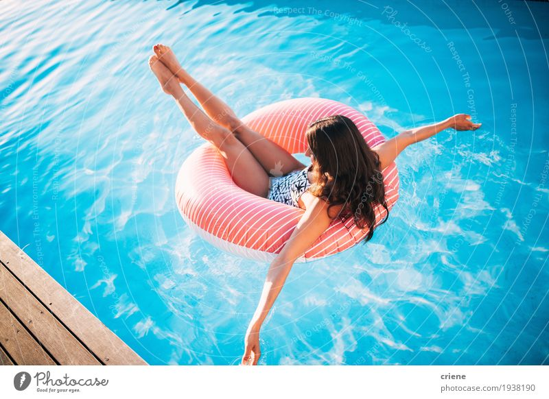 Attractive young women relaxing in swiming pool. Woman Vacation & Travel Youth (Young adults) Summer Young woman Beautiful Sun Relaxation Joy Adults Warmth
