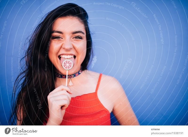Happy caucasian young women enjoying watermelon lollipop Woman Youth (Young adults) Blue Young woman Beautiful Hand Joy Adults Eating Lifestyle Happy Food Freedom Fruit Smiling Candy