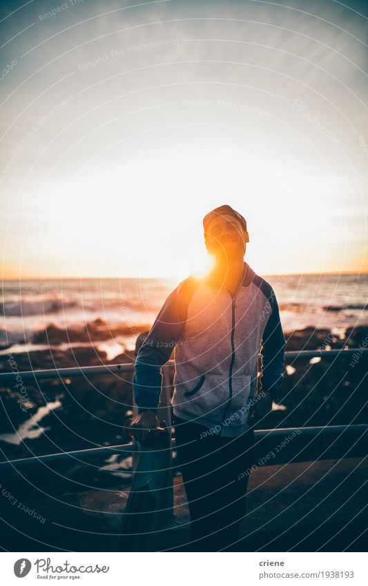 Young hipster adult with longboard in sunset on promenade Lifestyle Style Joy Leisure and hobbies Ocean Waves Sports Human being Masculine Young man