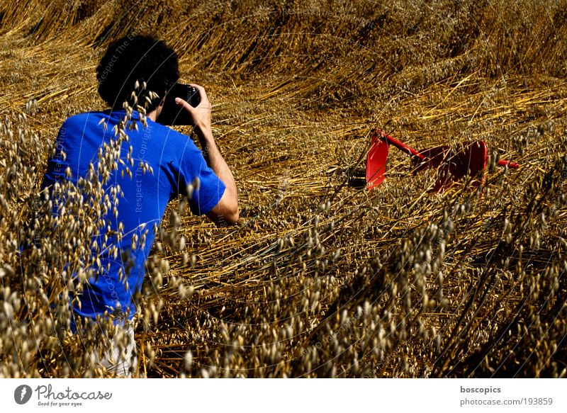 MAKING OF Leisure and hobbies Camera Human being Masculine Man Adults 1 Interest Take a photo Chair Cornfield Summer Blue Red Exterior shot Day Photography