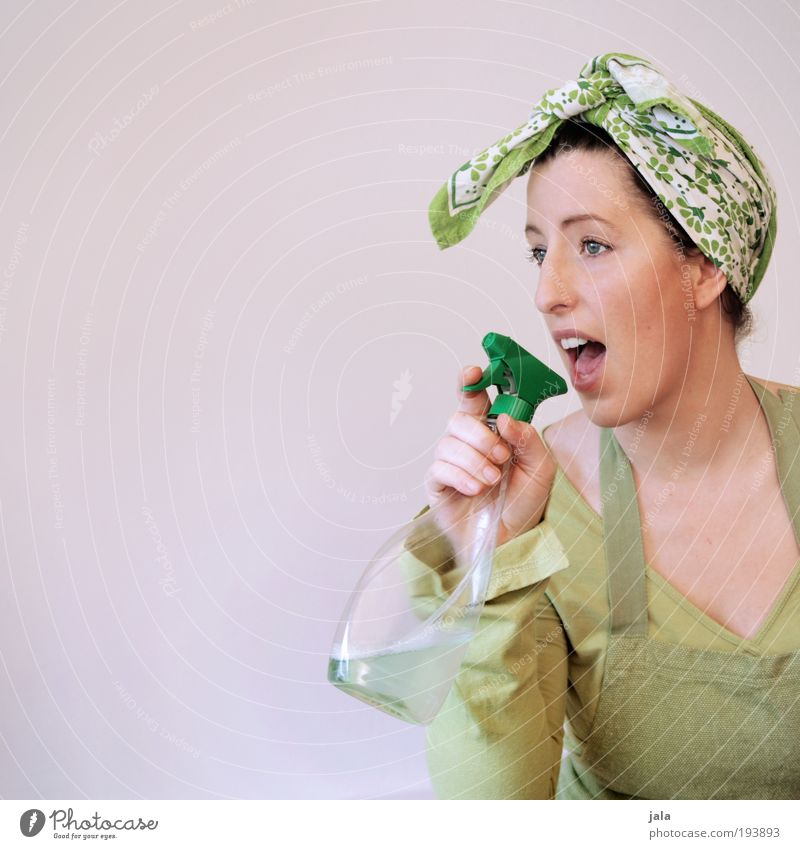 Woman Green Feminine Funny Adults Arrangement Clean Cleaning Portrait photograph Household chemicals Bottle Sing Looking Packaging Copy Space left Headscarf