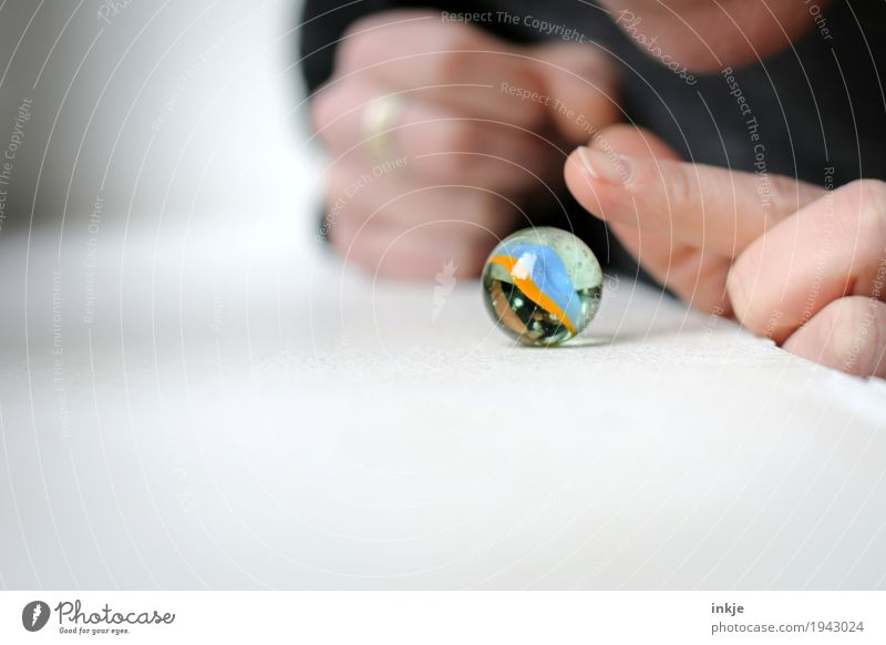 marbles Leisure and hobbies Playing Marble Hand Fingers 1 Human being Glass ball Touch Round Curiosity Interest Inspiration Caution Hesitate Colour photo