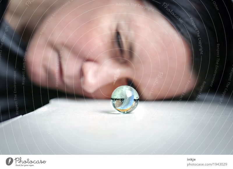 glass eye Leisure and hobbies Playing Woman Adults Face 1 Human being Marble Glass ball Observe Looking Small Round Curiosity Interest Discover Inspiration