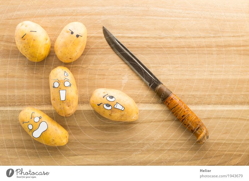 Potatoes in panic fear of a sharp armor knife Vegetable Cooking Nutrition Knives Chopping board Wood Metal Steel Creepy Delicious Funny Brown Black White