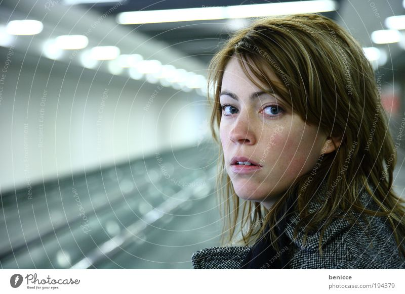 suprise Woman Human being Underground Loneliness Portrait photograph Fear Looking Winter wait Train station Modern Light Lamp Lighting Artificial Earnest